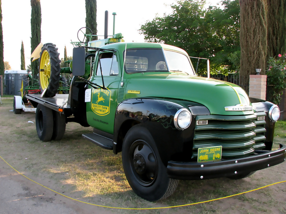 John Deere Trucks. Green ad black Chevy