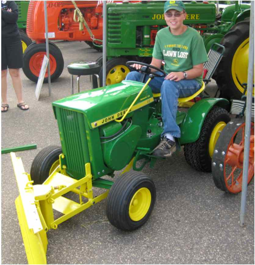 Use the John Deere 112 Tractor for Lawn Care Maintenance
