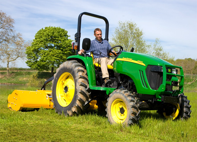 John Deere 4320 compact tractor with a mower