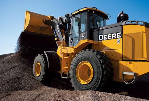 John Deere 644k hybrid unloading rocks