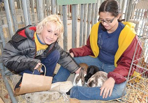 Students at the Ag Day Expo enjoy petting animals and learning about agriculture