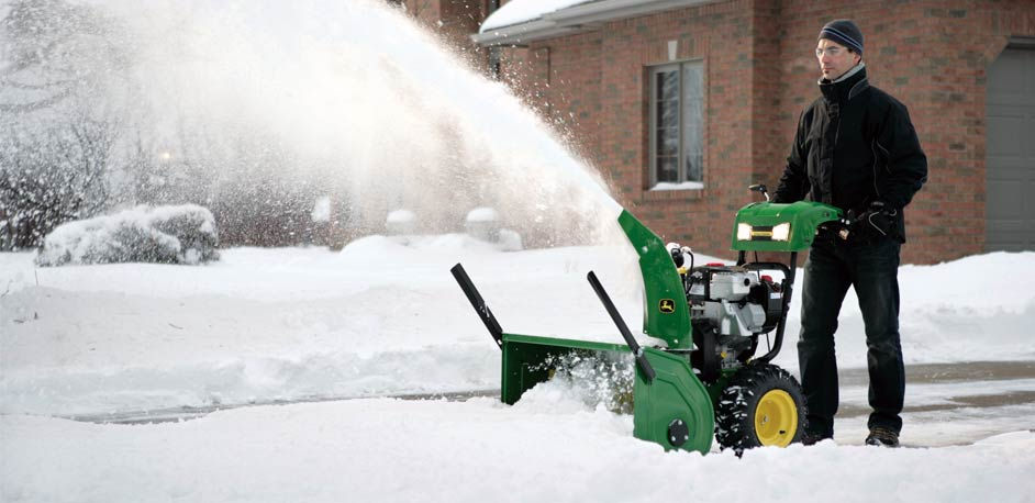 winter snow removal with JD snow blower