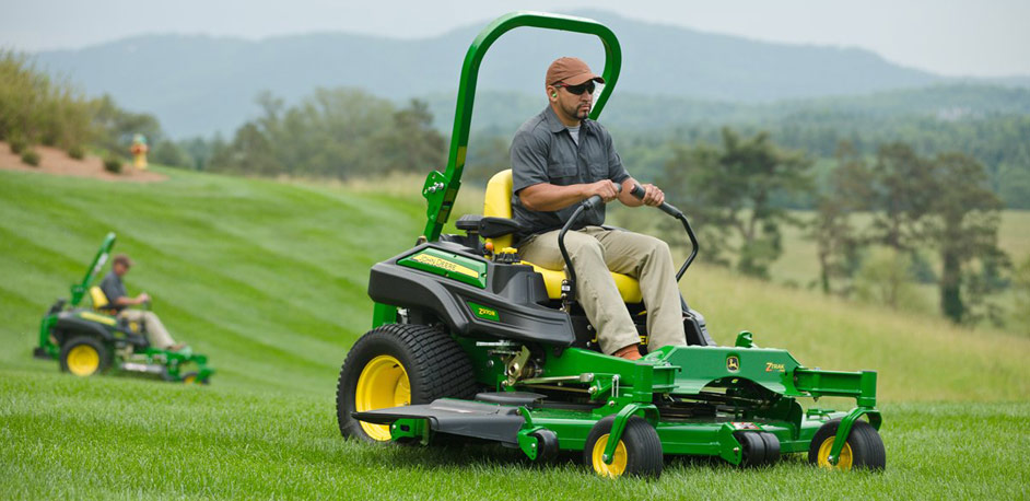 JD zero turn riding mower on grass
