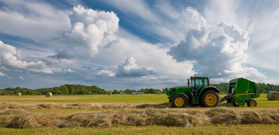 JD baler tractor baling hay