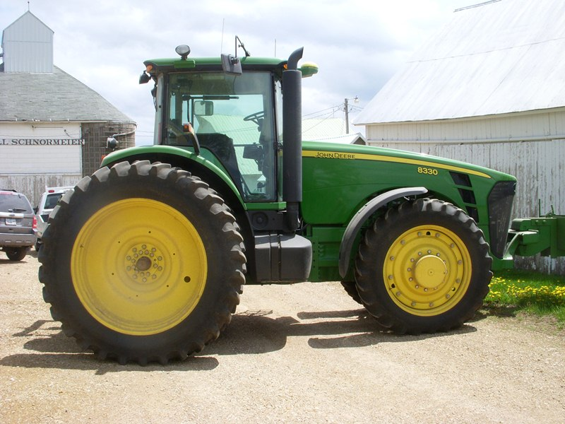 2010 JD 8330 tractor with 1,643 hours sold for $162,000 on a July 10, 2013 farm estate auction in north-central Iowa