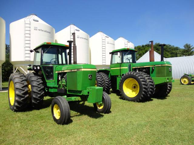 JD 4440 (left) and 8440 tractors sold very well on an October 10, 2013 farm retirement auction in south-central Saskatchewan, Canada