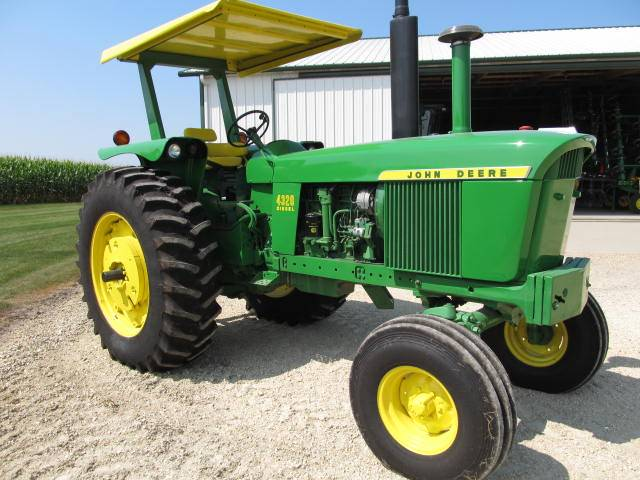 This restored 1972 JD 4320 diesel tractor with 7,000 hours sold for $31,250 on a November 2, 2013 farm auction in Springville, IA