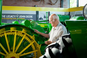The John Deere Collectors' Center once displayed antique tractor displays like these (above) and hosted auction events, before being part of a consolidation effort in downtown Moline