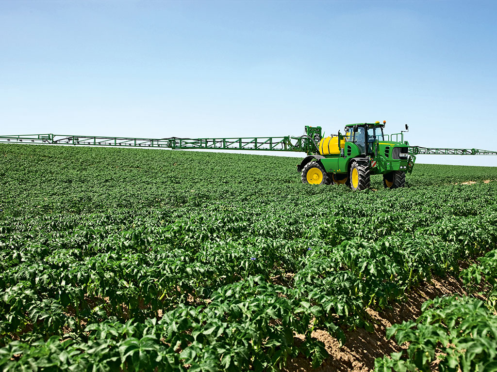 John Deere Sprayer in Field Distance