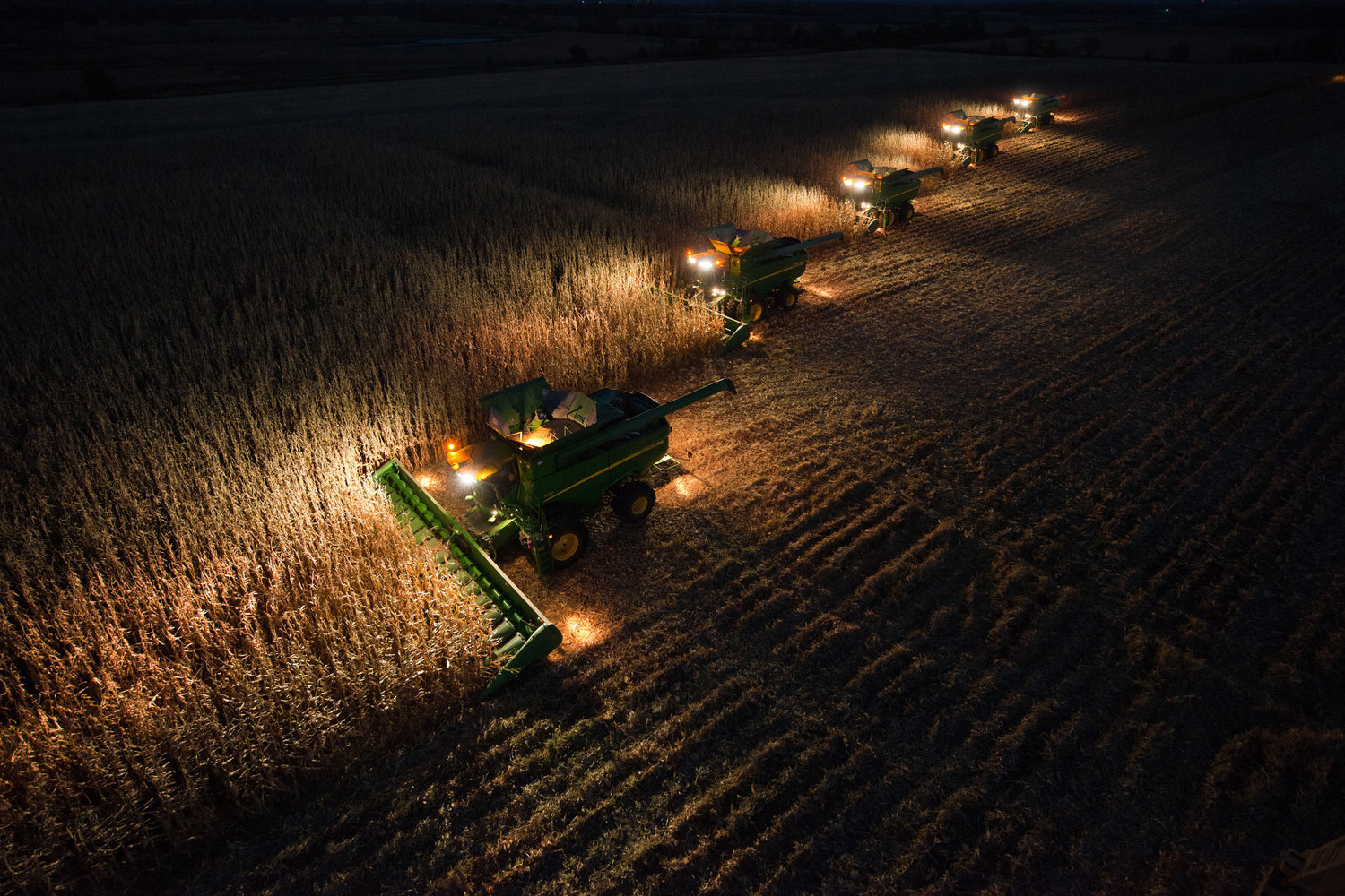 John Deere S Series Combines at Night