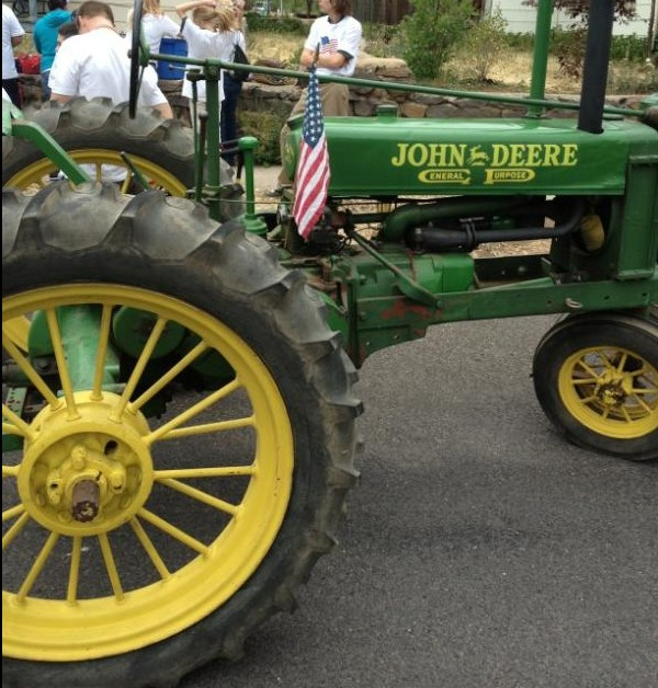 Antique John Deere tractor with flag