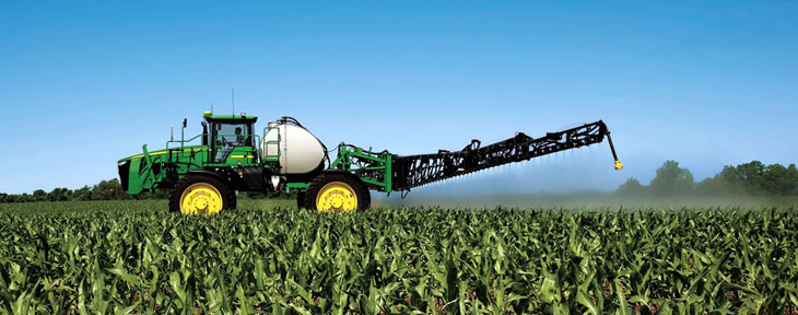 John Deere sprayer in field