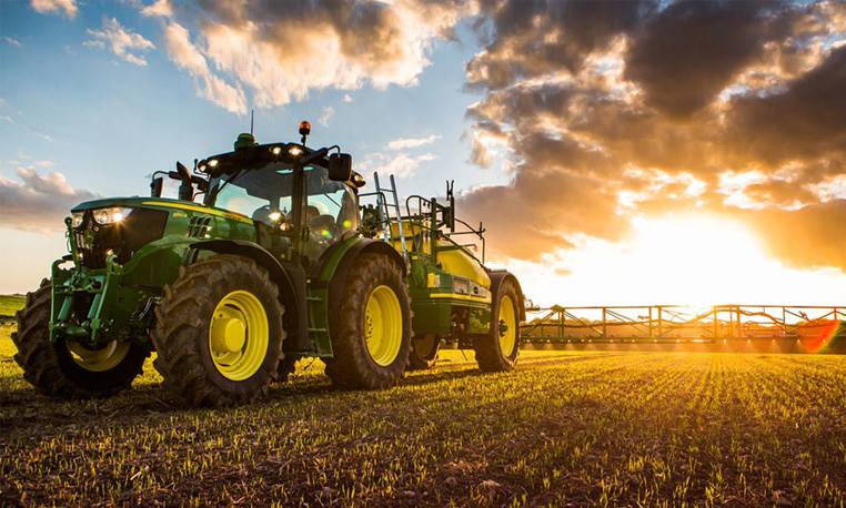 John Deere sprayer at sunset