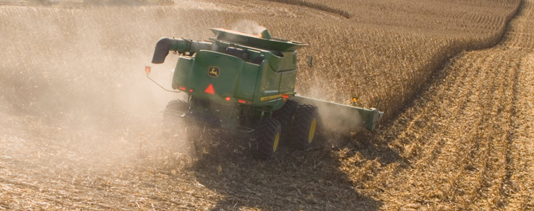 John Deere Combine Harvesting Corn