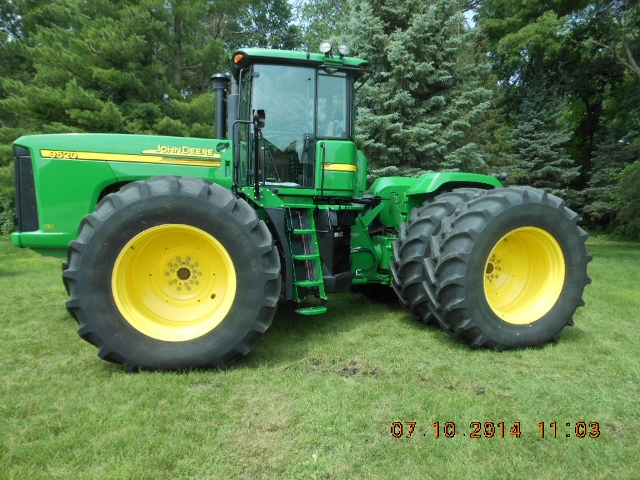 This 2007 JD 9520 4WD bareback tractor with only 519 hours sold for $171,000 on an August 26, 2014 farm auction in north-central Iowa