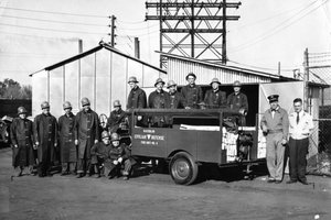 A photograph of the John Deere Fire Brigade in November 1951.