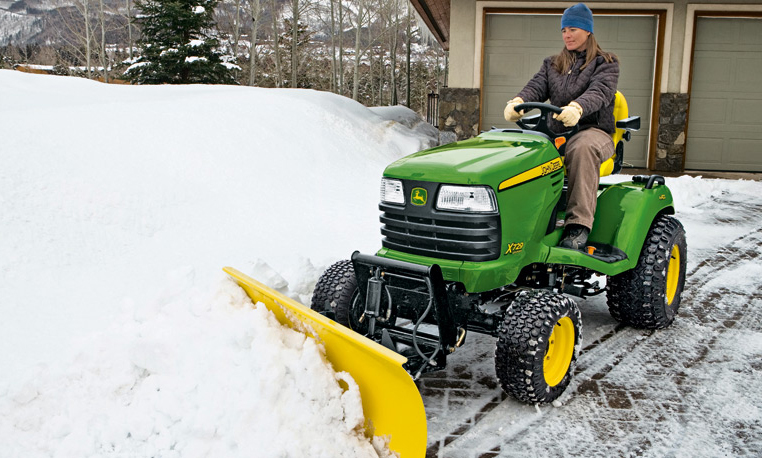 John Deere Tractor in Snow