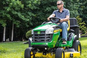 The E100 Series lawn tractors are designed for operator convenience with features like the 30-second oil change system.