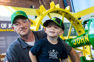 The John Deere Pavilion welcomed its four millionth guest, Kurt Snow, who celebrated the milestone with his three-year-old son.
